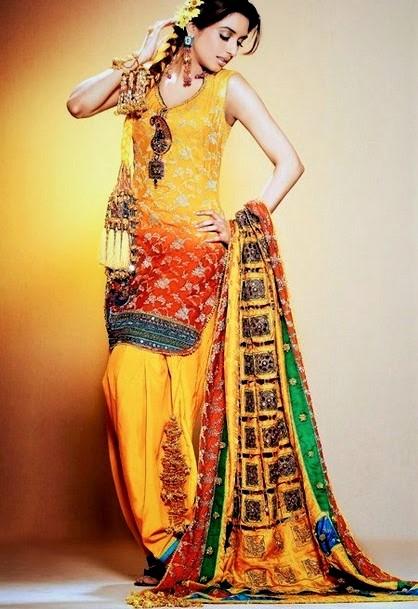 yellow Mehndi Dresses design by Pakistani Designers